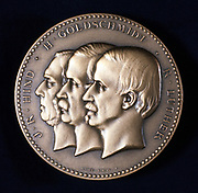 Hind, Goldschmidt and Luther, c1900. Medal commemorating the work of these three men on the discovery of planetoids (asteroids or minor planets).  From left to right: John Russell Hind (1823-1895), English astronomer who discovered 11 planetoids; Hermann Goldschmidt (1802-1866) German painter and astronomer who discovered 14 between 1852 and 1861, and Karl Theodor Robert Luther (1822-1900), German astronomer.