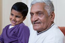 Grandfather holding grandson,
