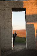 Sixteen year old Isabel having fun at Maryhill Stonehenge, a full-size, astronomically-aligned replica of Stonehenge located in Maryhill, Washington. It was commissioned in the early 20th century by businessman Samuel Hill and dedicated on July 4, 1918 as a memorial to those that died in World War I. The memorial was completed in 1929. It is constructed of concrete.