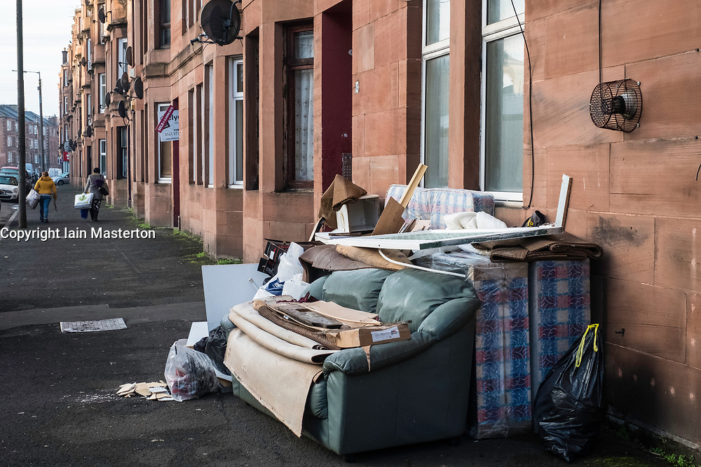 Rubbish left on pavement outside tenement apartment building in deprived Govanhill district of Glasgow, Scotland, United Kingdom