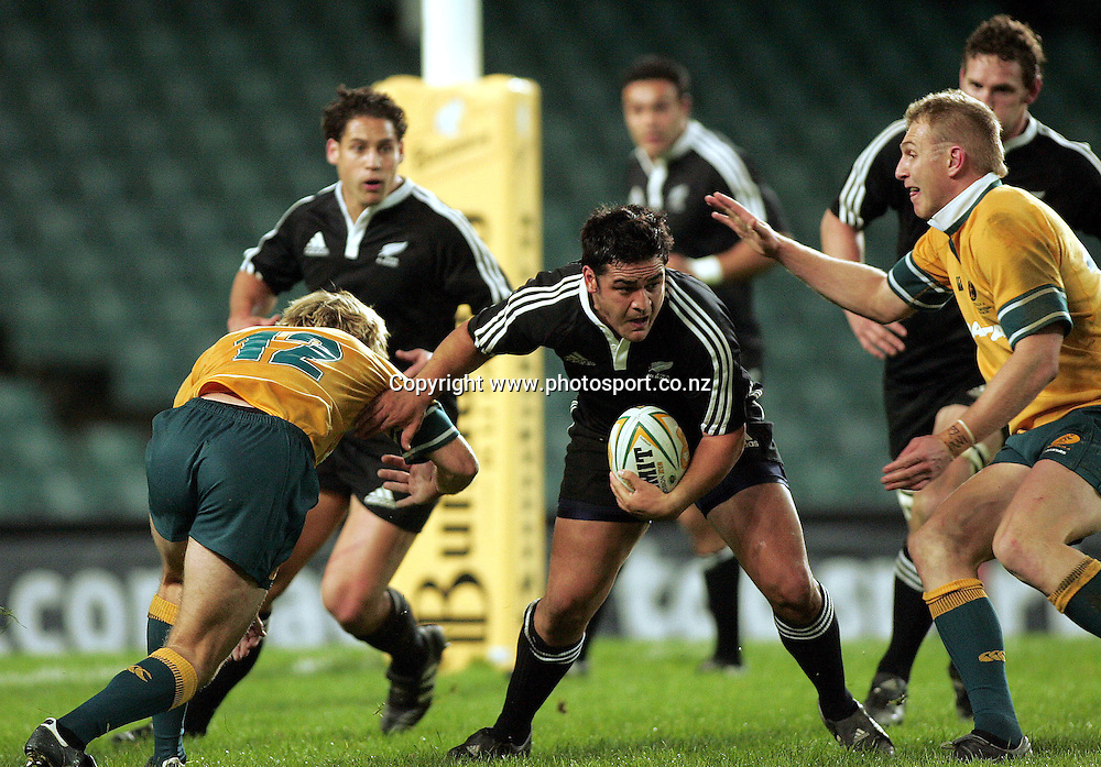 Piri Weepu beats Shaun Berne and Peter Hewat during the  Match between the Australia A v Junior All Blacks at Aussie Stadium, Sydney on 1 July 2005. The Junior Blacks won the game 34-29. Photo: Paul Seiser ©Seiser Photography/PHOTOSPORT