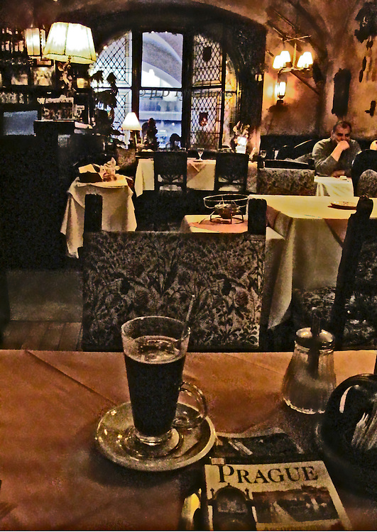 Every Prague restaurant and cafe serves its particular recipe for hot spiced wine.  This is wonderful for rest and refreshment after a morning or afternoon of winter walking and sightseeing.  The image, shot at ASA 1600, exhibits a lot of color noise, which may be interpreted as a digital pointillism if you are willing to be flexible.
