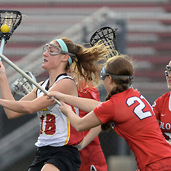 Staff photos by Tom Kelly IV<br /> Haverford's Mairead Janzer (18) shoots and scores past Plymouth Whitemarsh players including Cassie Ward (21).