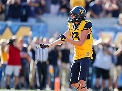 Oct 14, 2017; Morgantown, WV, USA; West Virginia Mountaineers wide receiver David Sills V (13) celebrates after scoring a touchdown during the fourth quarter against the Texas Tech Red Raiders at Milan Puskar Stadium. Mandatory Credit: Ben Queen-USA TODAY Sports