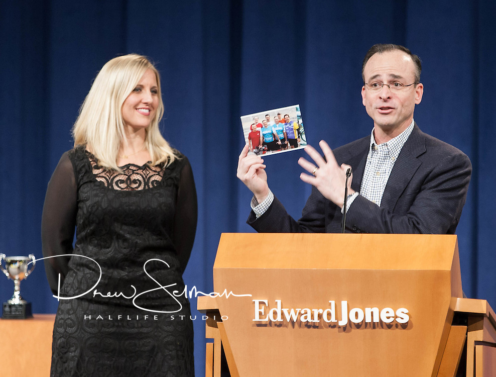 28 Feb 2015 - St. Louis  -- Pedal the Cause Chief Operations Officer Carrie Sweigart and Bob Holmes of The PrivateBank address guests at the PTC Yellow Jersey Celebration