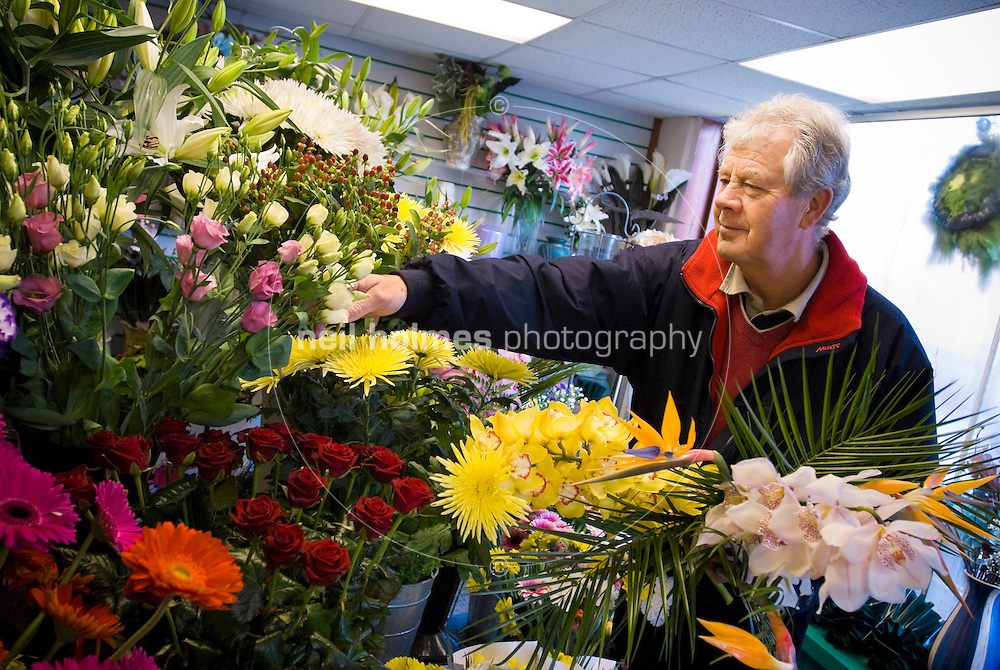 Stephen Wharram the florist arranges the display in his shop on Northgate