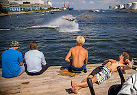 Copenhagen, Denmark- JULY 24, 2014:  An accomplished wakeboarder soars at Copenhagen Cable Park, where a series<br /> of suspended cables tow riders around the aquatic course. CREDIT: Chris Carmichael for The New York Times