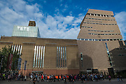 As the sun came out on the new building, long queues formed as Tate Members took advantage of their preview evening event. The new Tate Modern will open to the public on Friday 17 June. The new Switch House building is designed by architects Herzog & de Meuron, who also designed the original conversion of the Bankside Power Station in 2000.