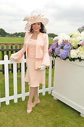 DAME JOAN COLLINS at the Cartier Queen's Cup Polo final at Guard's Polo Club, Smiths Lawn, Windsor Great Park, Egham, Surrey on 14th June 2015