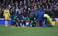 Manchester United's Robin van Persie check to see if  Manchester United's Phil Jones is okay after his head injury. - Photo mandatory by-line: Alex James/JMP - Tel: Mobile: 07966 386802 01/02/2014 - SPORT - FOOTBALL - Britannia Stadium - Stoke-On-Trent - Stoke v Manchester United - Barclays Premier League
