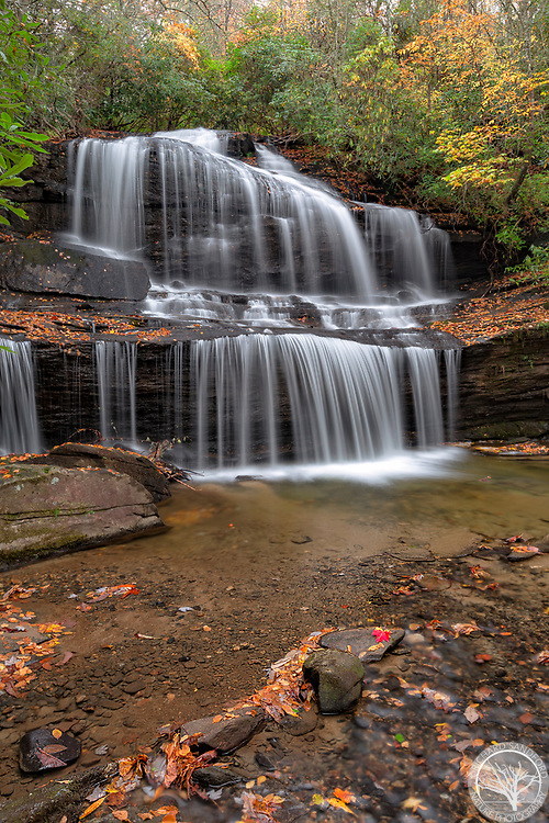 Woods Cove Falls, with fall foliage. Near Brevard, North Carolina. On private property.