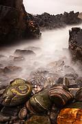 Striated boulders, incoming tide, Bettyhill beach, Northern Scotland