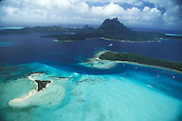 French Polynesia, Islands in the South Pacific, part of the French overseas Territories...Photo by Owen Franken..aerial view of Bora Bora, with Motos (little islands)...Photo by Owen Franken