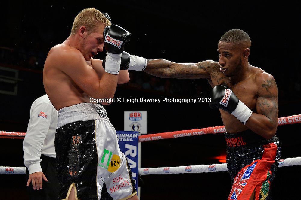 Andrew Robinson (black/red shorts) defeats Dan Blackwell in a Super Middleweight contest at Wolverhampton Civic Hall, Wolverhampton, 1st August 2014. Frank Warren in association with PJ Promotions.  © Credit: Leigh Dawney Photography.