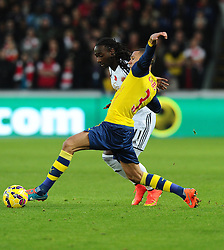 Arsenal's Kieran Gibbs battles for the ball with Swansea City's Marvin Emnes  - Photo mandatory by-line: Joe Meredith/JMP - Mobile: 07966 386802 - 09/11/2014 - SPORT - Football - Swanswa - Liberty Stadium - Swansea City v Arsenal - Barclays Premier League