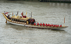 © Licensed to London News Pictures. 09/09/2015. London, UK. British royal rowbarge Gloriana leading the flotilla as it passes along the river thames in front of HMS Belfast. A Royal River Salute takes place at Tower Bridge in London to mark the Queen becoming the longest reigning monarch in British history. The Queen will have reigned for 63 years and seven months , passing the record set by her great-great-grandmother Queen Victoria. Photo credit: Ben Cawthra/LNP