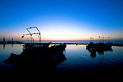 fishing boat at sunset in the Mediterranean Sea