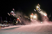 EAGLE RIVER, WI-JAN. 15, 2016: Snocross racers during Friday Night Thunder at The AMSOIL Snowmobile World Championships in Eagle River, WI, Friday, Jan. 15. Eagle River is the Snowmobile Capital of the World. Lauren Justice for The New York Times