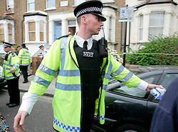 UK ENGLAND LONDON 22JUL05 - A Metropolitan Police officer moves people from a cordoned off area following an incident on a No. 18 bus on the Harrow Road. Apparently shots were fired as two suspected bombers fled the scene...jre/Photo by Jiri Rezac ..© Jiri Rezac 2005..Contact: +44 (0) 7050 110 417.Mobile:  +44 (0) 7801 337 683.Office:  +44 (0) 20 8968 9635..Email:   jiri@jirirezac.com.Web:    www.jirirezac.com..© All images Jiri Rezac 2005 - All rights reserved.