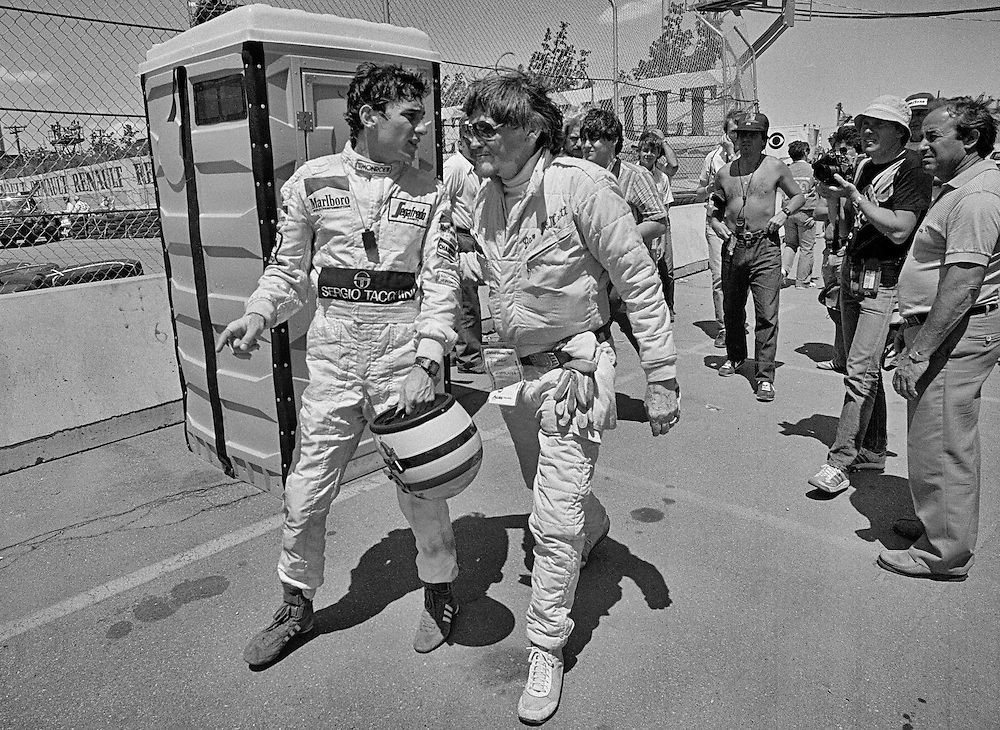 Brazilian Formula One driver Ayrton Senna is attended to by trackside medical personnel at the 1984 Detroit Grand Prix. Senna's Toleman-Hart had lost its brakes on the long front straight during practice and Senna collided with the tire barrier in Tune One. He was unhurt, but during the race, the Toleman sheared off its right rear wheel in the same place, and Senna met the tire wall a second time.<br />