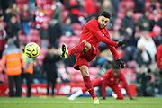 Liverpool midfielder Alex Oxlade-Chamberlain (15) warming up during the Premier League match between Liverpool and Brighton and Hove Albion at Anfield, Liverpool, England on 30 November 2019.