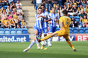 Colchester Utd midfielder Drey Wright and Cambridge Utd midfielder James Dunne clash during the EFL Sky Bet League 2 match between Colchester United and Cambridge United at the Weston Homes Community Stadium, Colchester, England on 13 August 2016. Photo by Nigel Cole.