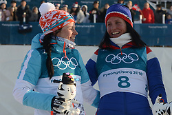 February 25, 2018 - Pyeongchang, South Korea - KRISTA PARMAKOSKI of Finland and MARIT BJOERGEN of Norway at the ceremony following  the Ladies' 30km Mass Start Classic cross-country ski racing event in the PyeongChang Olympic Games. (Credit Image: © Christopher Levy via ZUMA Wire)