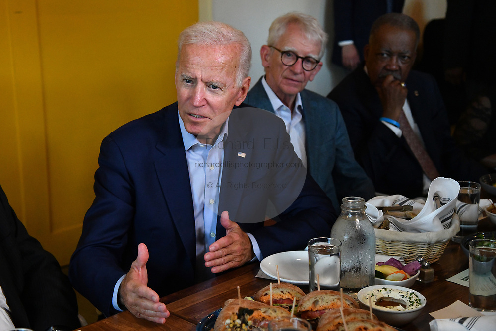 Former Vice President Joe Biden speaks briefly during a lunch with local officials as former Charleston Mayor Joe Riley, right, looks on at the Butcher and Bee July 7, 2019 in Charleston, South Carolina.