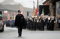 The local Remembrance Day Parade in Chapeltown Sheffield South Yorkshire   led to the War Memorial in Chapeltown Park by local community constable PC Peter Booth on Sunday. ..13 November 2011. Image © Paul David Drabble