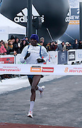 Winner Martin Mukele of Kenia on finish line of The 8th Warsaw Half Marathon on March 24, 2013...Poland, Warsaw, March 24, 2013...Picture also available in RAW (NEF) or TIFF format on special request...For editorial use only. Any commercial or promotional use requires permission...Photo by © Adam Nurkiewicz / Mediasport