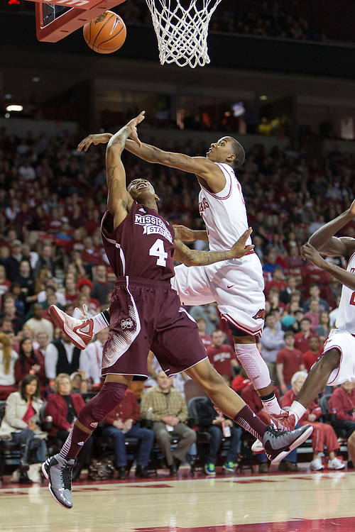 FAYETTEVILLE, AR - JANUARY 23:  Trivante Bloodman #4 of the Mississippi State Bulldogs takes a shot under pressure from BJ Young #11 of the Arkansas Razorbacks at Bud Walton Arena on January 23, 2013 in Fayetteville, Arkansas. The Razorbacks defeated the Bulldogs 96-70.  (Photo by Wesley Hitt/Getty Images) *** Local Caption *** Trivante Bloodman; BJ Young