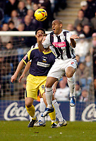 Photo: Leigh Quinnell.<br /> West Bromwich Albion v Derby County. Coca Cola Championship. 02/12/2006. West Broms Nigel Quashie out jumps Derbys Steve Howard.