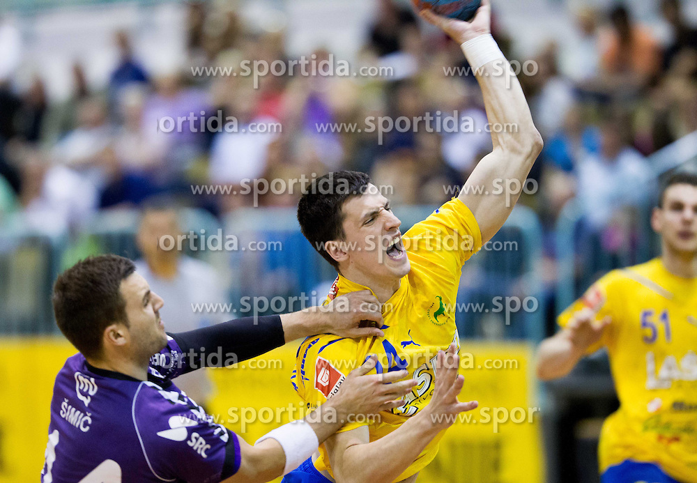 Rok Simic of Maribor Branik vs Nemanja Zelenovic of Celje during handball match between RK Maribor Branik and RK Celje Pivovarna Lasko of 1st NLB Leasing League 2012/13, on April 24, 2013, in Arena Tabor, Maribor, Slovenia. (Photo By Vid Ponikvar / Sportida.com)