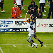 18 November 2017:  The San Diego State football team hosts Nevada Saturday night. San Diego State Aztecs wide receiver Mikah Holder (6) catches a pass for first down while being defended by Nevada Wolf Pack defensive back Elijah Moody (18) in the third quarter. The Aztecs beat the Wolf Pack 42-23 at SDCCU stadium. <br /> www.sdsuaztecphotos.com