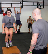 (from left) Aaron Pertner of Dayton, Anne Keeton of Kettering, Chad Banter of Centerville, Kerry Penner of Dayton and owner Jason Hoskins of Dayton during a workout of the day session at Vigor Crossfit in Moraine, Wednesday, January 25, 2012.