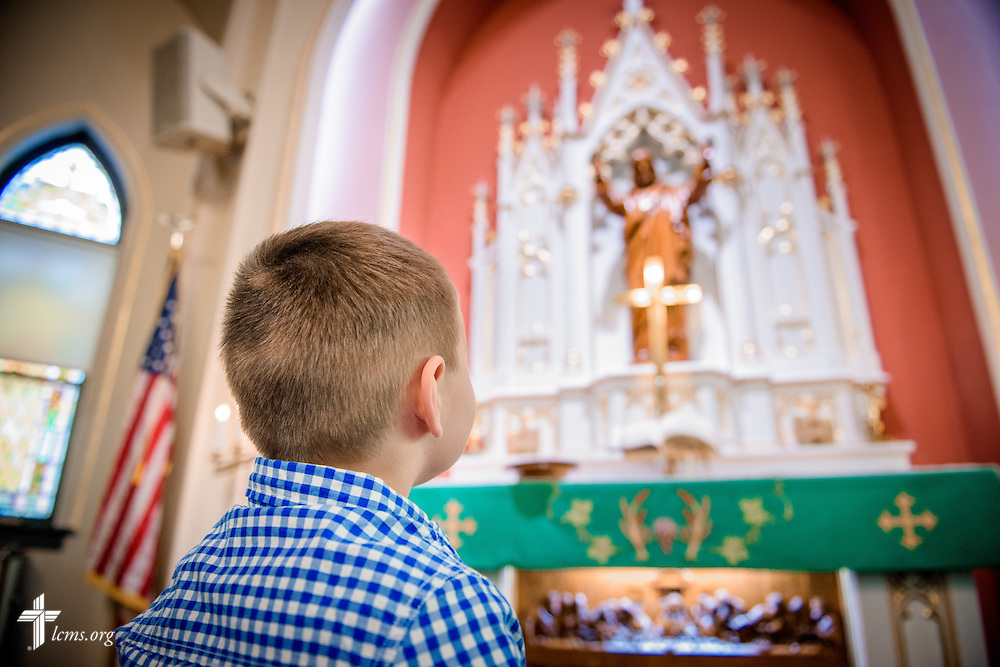 A young boy eyes the altar following worship on Saturday, Oct. 1, 2016, at St. John's Lutheran Church in Beardstown, Ill. LCMS Communications/Erik M. Lunsford