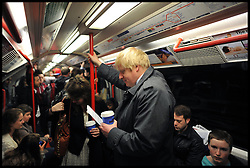 London Mayor Boris Johnson on the London underground during the Mayoral Campaign, London, UK, April 13, 2012. Photo By Andrew Parsons / i-Images.