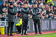 Fourth official Willie Collum, Aberdeen assistant manager Tony Docherty and Aberdeen manager Derek McInnes in the technical area during the Ladbrokes Scottish Premiership match between Heart of Midlothian FC and Aberdeen FC at Tynecastle Stadium, Edinburgh, Scotland on 29 December 2019.