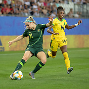 GRENOBLE, FRANCE June 18.  Ellie Carpenter #21 of Australia crosses the ball defended by Deneisha Blackwood #14 of Jamaica during the Jamaica V Australia, Group C match at the FIFA Women's World Cup at Stade des Alpes on June 18th 2019 in Grenoble, France. (Photo by Tim Clayton/Corbis via Getty Images)