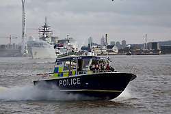 © Licensed to London News Pictures. 24/01/2016.  The River-class navy vessel HMS Severn has arrived in London for a four day visit during which she will celebrate the 150th anniversary of the London Fire Brigade. She was met by the fire boat Fire Dart and given a water salute at North Greenwich. Credit: Rob Powell/LNP