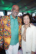 Water Mill, New York: (L-R) Visual Artist Danny Simmons and Loida Lewis, Chair and CEO of TLC Beatrice International attend the RUSH Philanthropic Arts Foundation 15th Annual Art For Life Benefit Gala held in the Hamptons at the Farmview Farms on July 26, 2014  in Water Mill, New York. (Terrence Jennings)