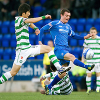 St Johnstone v Celtic...18.12.11   SPL <br /> Ki Sung Yeung and David Robertson<br /> Picture by Graeme Hart.<br /> Copyright Perthshire Picture Agency<br /> Tel: 01738 623350  Mobile: 07990 594431