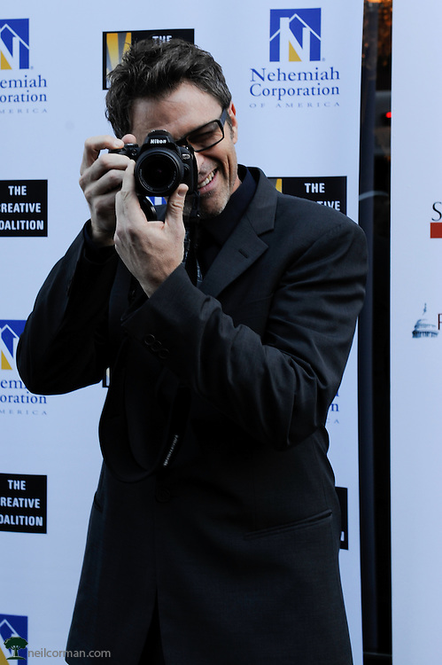 August 27, 2008 - Actor Tim Daly has some fun with the media while attending the Spotlight Initiative Award Morning Reception Honoring Annette Bening during the 2008 Democratic National Convention in Denver.