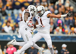 Oct 28, 2017; Morgantown, WV, USA; Oklahoma State Cowboys wide receiver James Washington (28) scores a touchdown and celebrates with Oklahoma State Cowboys wide receiver Jalen McCleskey (1) during the first quarter against the West Virginia Mountaineers at Milan Puskar Stadium. Mandatory Credit: Ben Queen-USA TODAY Sports