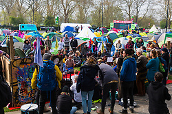 Protesters discuss the day's events ahead of more direct action as hundreds of environmental protesters from Extinction Rebellion occupy Marble Arch, camping in the square and even on the streets, blocking access to traffic on Park Lane and Oxford Street in London's usually traffic-heavy west end. . London, April 16 2019.