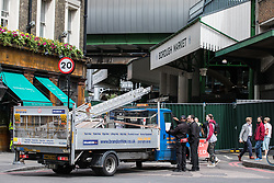 © Licensed to London News Pictures. 12/06/2017. London, UK. A construction van waits to enter Borough Market as traders begin clearing up and prepare to reopen. The market was the scene of a terrorist attack on Saturday 3 June 2017 in which eight people were killed. Photo credit: Rob Pinney/LNP