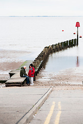Sitting on the Sea defenses near close to the Pier Cleethorpes Lincolnshire..1 July 2012.Image © Paul David Drabble