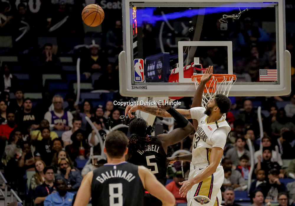 Dec 3, 2018; New Orleans, LA, USA; New Orleans Pelicans forward Anthony Davis (23) blocks a shot by LA Clippers forward Montrezl Harrell (5) during the second half at the Smoothie King Center. Mandatory Credit: Derick E. Hingle-USA TODAY Sports