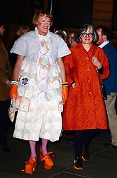 Grayson Perry (L) with Philippa Perry  attends a VIP private view of David Bailey: Bailey's Stardust, a major exhibition showcasing the work of acclaimed fashion photographer David Bailey, providing a retrospective of his career during which he has photographed stars including The Beatles, Andy Warhol and Jack Nicholson. Sponsored by Hugo Boss, at National Portrait Gallery, St Martin's Place,  London, United Kingdom. Monday, 3rd February 2014. Picture by Nils Jorgensen / i-Images