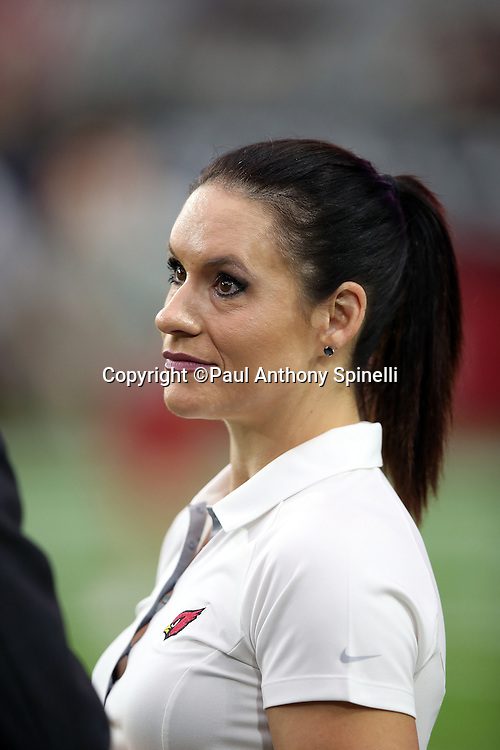 Arizona Cardinals coach Jen Welter, the first female coach in the NFL, talks on the sideline before the 2015 NFL preseason football game against the Kansas City Chiefs on Saturday, Aug. 15, 2015 in Glendale, Ariz. Welter's credentials include a phD and an MS in Sports Psychology. The Chiefs won the game 34-19. (©Paul Anthony Spinelli)